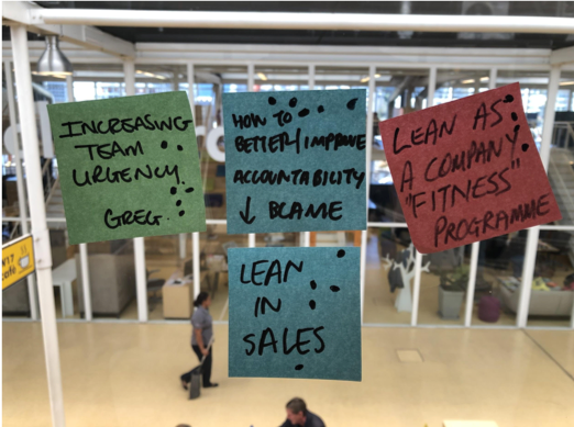 Post-it notes are used to suggest potential topics of discussion at Lean Coffee